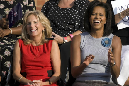 Michelle Obama and Jill Biden laugh together.